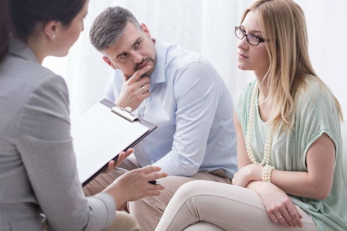 Couple talking to family law mediator