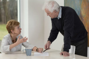 older couple arguing over paperwork
