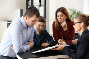 parents and child visiting a child custody attorney