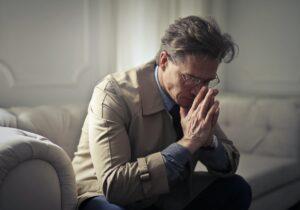 sad man sitting alone - gray divorce