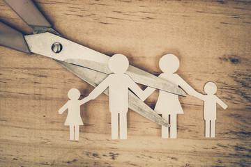 Scissors cutting paper cut of family