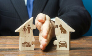 a lawyer dividing a wooden puzzle with pictures of couples property during a divorce process