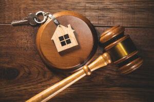 Judge gavel and house key