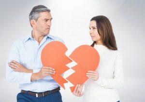 couple holding a broken heart - gray divorce concept